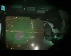 What a laser pointer looks like from the cockpit of a helicopter. - YOUTUBE