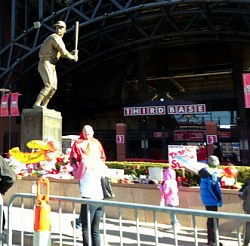 The Musial statue outside Busch Stadium has become a place of pilgrimage for the Cardinals faithful. - IMAGE VIA