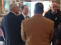 Francis Slay schmoozing with some of the city's Muslim leaders. - SAM LEVIN