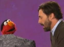 Jon and Elmo. - VIA YOUTUBE