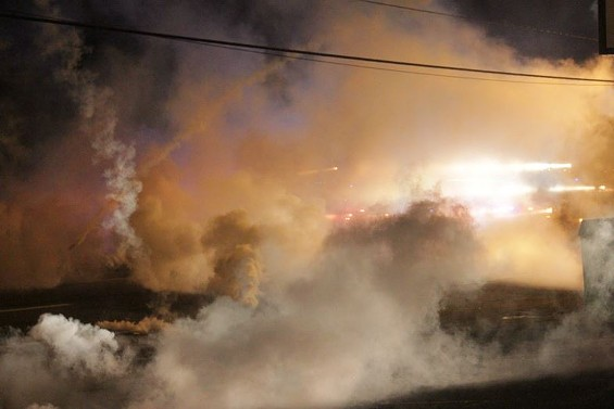 Tear gas wafts over West Florissant Avenue Sunday night - PHOTO BY DANNY WICENTOWSKI
