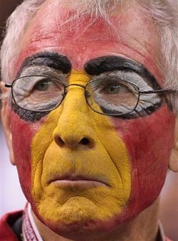 Just don't paint your face like this guy. It's too pathetic. - IMAGE VIA