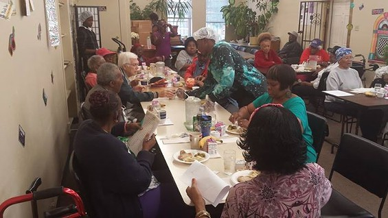 Students serve hot meals to seniors at Northside Youth and Senior Service Center. - COURTESY OF NORTHSIDE