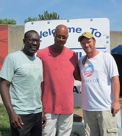 Reed and community activist Brian Matthews (right) stand beside Hopeville camp leader, Moe. - PHOTOS: RORY ROUNDTREE