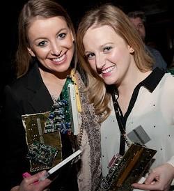 Meme Girls: Herzog and Derus display their RFT Web Awards hardware.