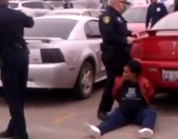 Pregnant woman handcuffed after she was tased. - VIA YOUTUBE