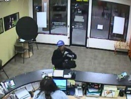 Surveillance still of Chrice Shunta Combs robbing a Cash Store payday loan shop in Southern Illinois in 2010.