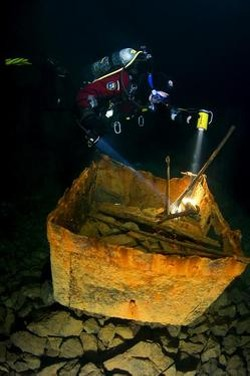 A diver examines an old iron ore cart abandoned in the Bonne Terre mines.