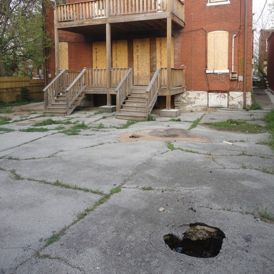 A giant pothole in Tower Grove East. - PAUL SABLEMAN, FLICKR