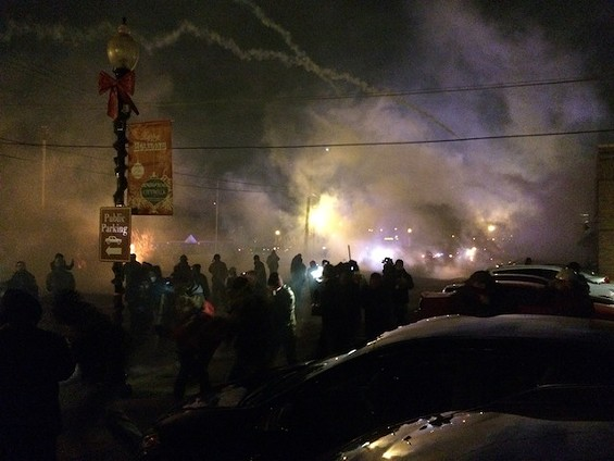 Tear gas wafts over South Florissant Road Monday night. - MITCH RYALS