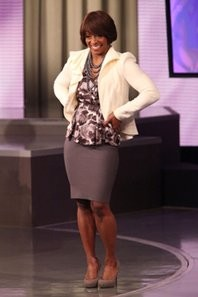Frisby on the Oprah set, after her makeunder. A great look for the classroom, not so much for going out. - IMAGE SOURCE