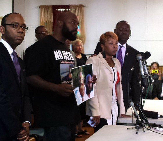 NAACP President Cornell Brooks, Michael Brown Sr., Lesley McSpadden and attorney Benjamin Crump. - JESSICA LUSSENHOP