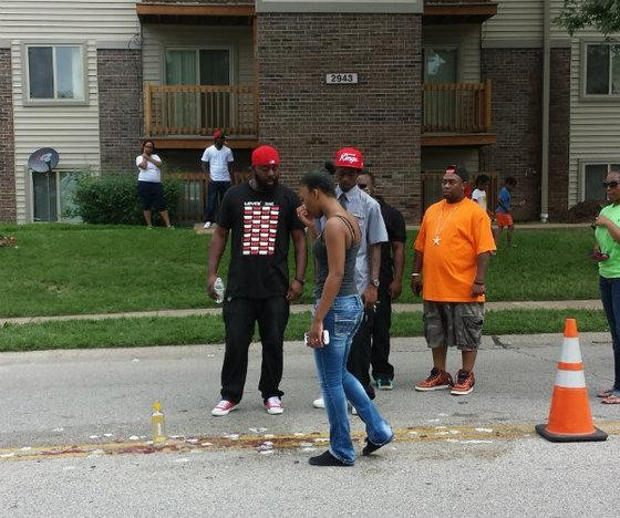 The scene on Canfield Drive where Brown was shot and killed August 9. - JESSICA LUSSENHOP