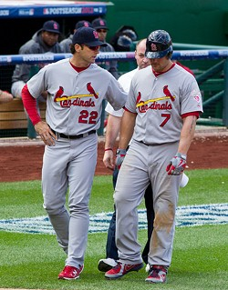 Mike Matheny walks with Matt Holliday at a National League Division series game in 2012. - KEITH ALLISON ON FLICKR