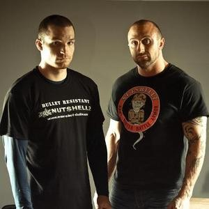Jeremiah Raber (right) with one of Nutshellz sponsored MMA fighters. - ARMOREDNUTSHELLZ.COM