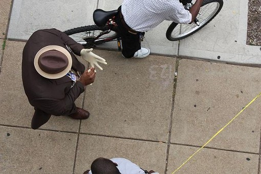 """A homicide detective about to step over the """"Caution"""" tape. - PHOTO BY NICHOLAS PHILLIPS"""