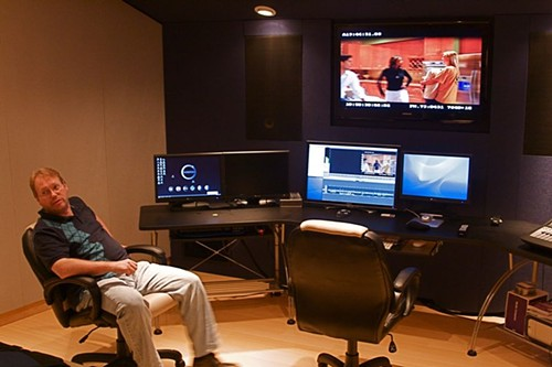 Local filmmaker Jack Snyder checks the mix of a project in Shock City's video suite. (click image for larger view) - PHOTO BY: BILL STREETER