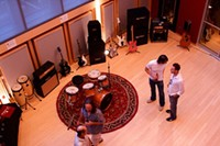 Attendees check out the 1,100 sq ft. live studio at Shock City's open house last month. (Click for larger view) - PHOTO BY: BILL STREETER