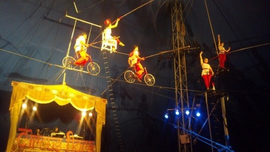 The Flying Wallendas make their way across the high wire.