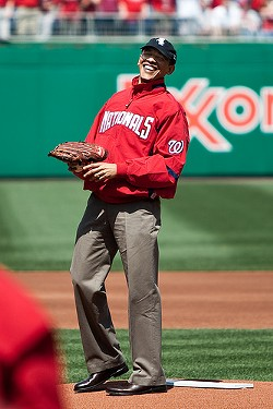 President Barack Obama in a Nationals jersey and White Sox hat. - MISS CHATTER ON FLICKR