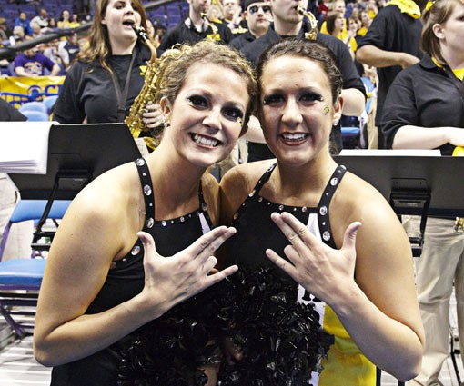 "Shocker dancers giving their ""gang"" sign. - PHOTO: STEVE TRUESDELL"