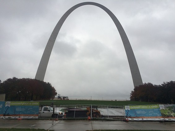"""Engineers removed windows and opened the hatch at the top of the Arch Tuesday to prepare for """"industrial rope access"""" to take stain samples. - MITCH RYALS"""