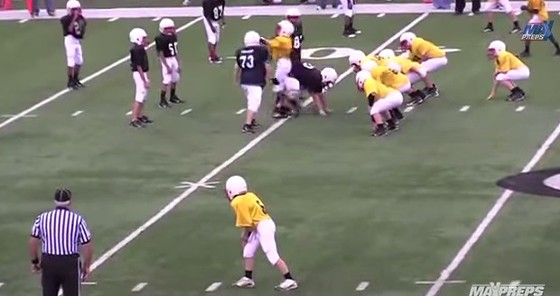"""The quarterback (center yellow) is about to get all """"Ugly Kardashian"""" on the opposing team. - MAXPREPS ON YOUTUBE"""
