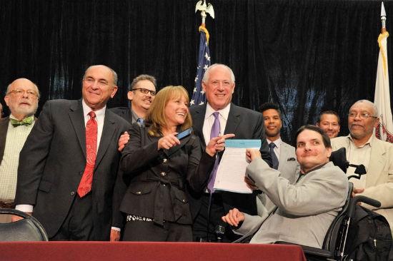 Governor Pat Quinn signing the legislation yesterday. - VIA FACEBOOK
