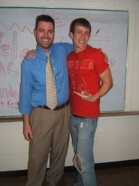 Dan DeLong and a student in this undated photo. - IMAGE VIA LEZGETREAL.COM