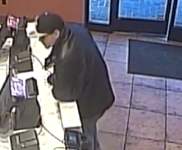 Surveillance footage shows a bad guy with a BB gun holding up the Taco Bell near Dogtown. - VIA SLMPD