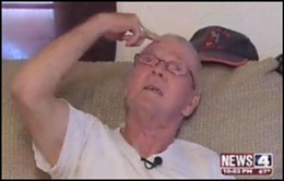 Ed Gischer of Lemay shows how the burglar pointed a gun to his head - IMAGE VIA