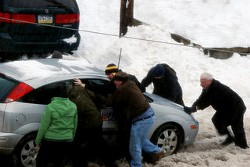 The storm caused cars to slide off the road. - CHRISTOPHER RICE ON FLICKR