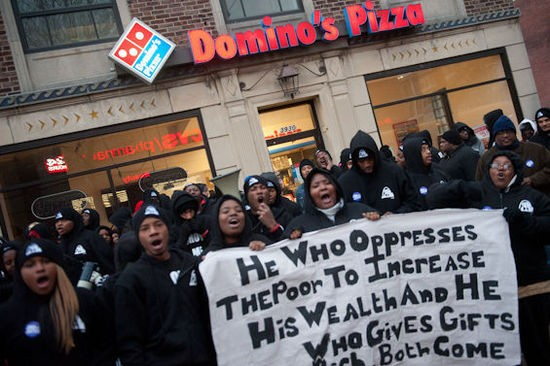 Fast food workers strike across St. Louis. - JON GITCHOFF