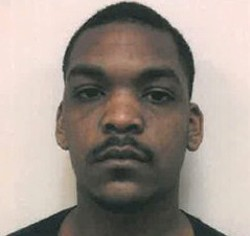 Marlon Miller, shown here in his mugshot after being charged for a rape he didn't commit.