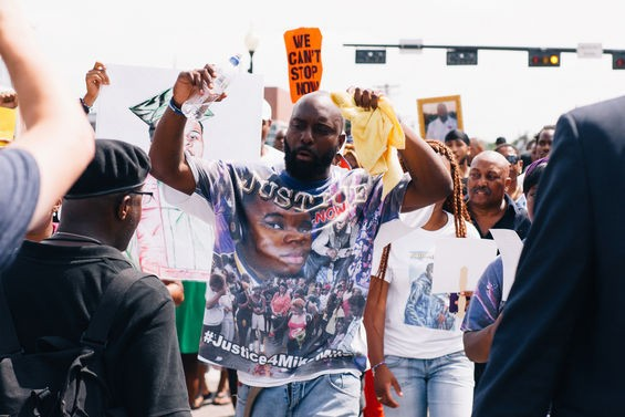 Michael Brown, Sr., Brown's father, marches in Ferguson.