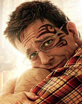 Ed Helms wears copyright protected ink.