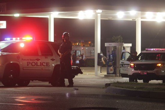 The gas station at  the intersection of Chambers Road and Florissant Avenue served as a major staging area for police on Sunday night. - DANNY WICENTOWSKI