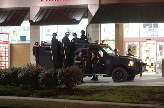 A heavily armed SWAT team hung out at this Walgreen's at Chambers Road and Florissant Avenue around midnight. - DANNY WICENTOWSKI