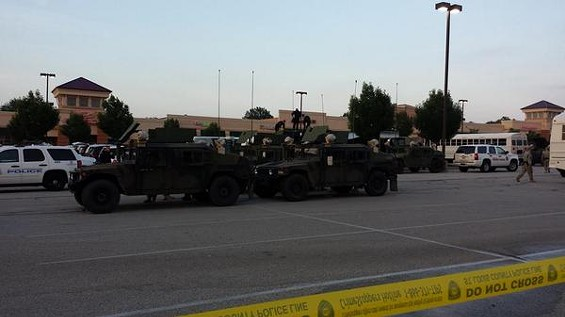 The National Guard stations at the command post before night falls in Ferguson. - JESSICA LUSSENHOP
