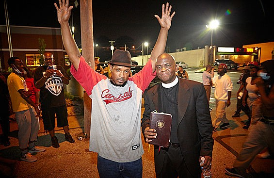 Ferguson protesters and clergy are the 2014 people of the year in Time magazine, Gawker and HuffPost Religion. - STEVE TRUESDELL