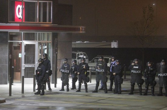 St. Louis cops in riot gear guard a QuikTrip in the Grove on October 12. Three days before, an officer shot and killed eighteen-year-old Vonderrit Myers Jr. - DANNY WICENTOWSKI