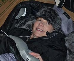 """St. Louis Circuit Attorney Jennifer Joyce keeps warm in her """"Elmer Fudd"""" hat."""