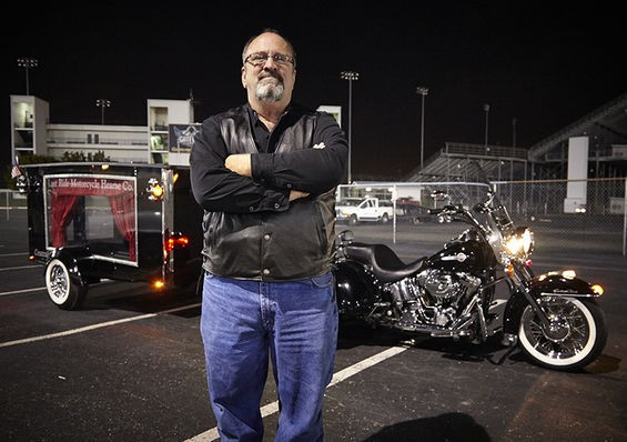 Mike Sutherland in front of his Harley hearse at Monster Mass at Gateway Motorsports Park. - PHOTO BY STEVE TRUESDELL