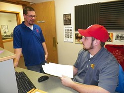 Sam Schleicher and Rob Edwards at the radio station in Sedalia. - 105.7 FM