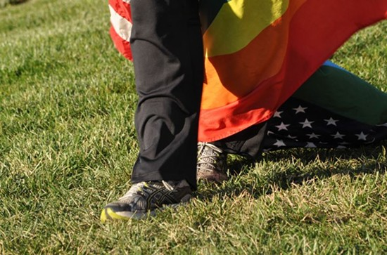 WBC picketers tied American and rainbow flags to their legs so that they would trample them with each step. - DANNY WICENTOWSKI