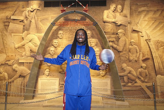 Slick Willie Shaw of the Harlem Globetrotters is pretty darn tall. Not quite as tall as the Gateway Arch, but tall. See more photos. - STEVE TRUESDELL