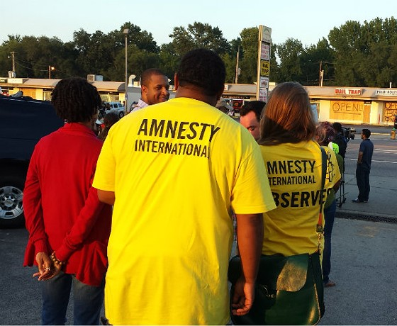 Amnesty International out in Florissant last night. - JESSICA LUSSENHOP