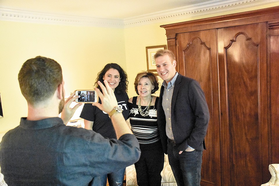 Campaign manager Claire Botnick and VanOstran pose with Democratic booster Anne Bedwinek. Botnick's husband, Aaron Davidowitz takes the photo. - DOYLE MURPHY