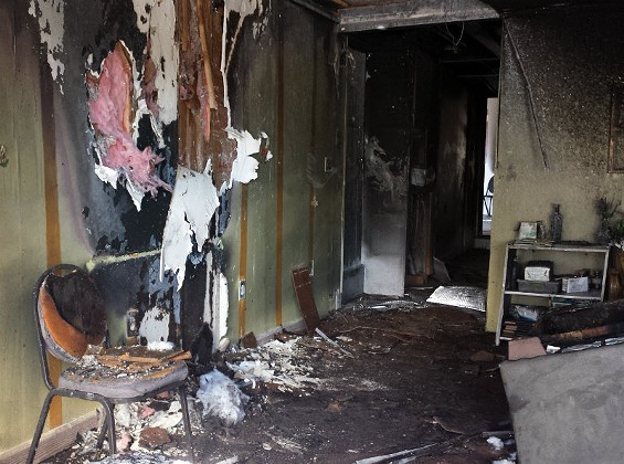 Fire damage in the front room of the Flood Church on West Florissant. - JESSICA LUSSENHOP