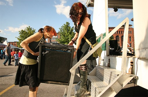 Two members of the 75's move their gear onto the stage. See more photos from Saturday. - PHOTO: NICK SCHNELLE